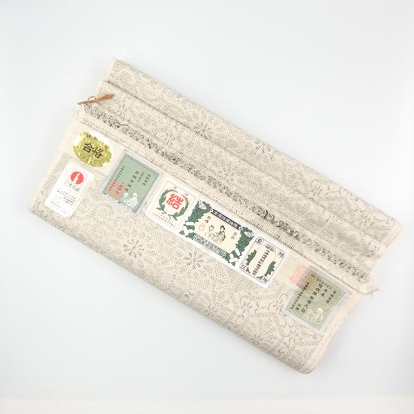 小倉商店 本場結城紬 100亀甲 白よごしたたんである画像