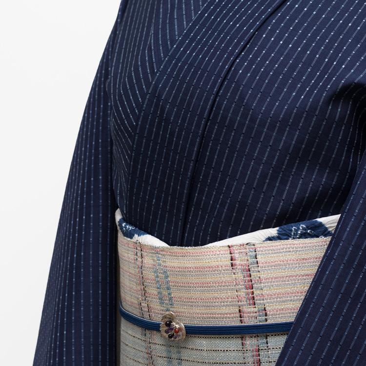 山口良子 首里花織・ロートン織の着尺と山岸幸一の八寸帯のコーディネート